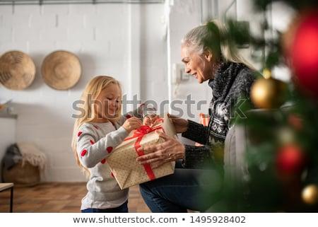 Kıdemli kadın meraklı Noel hediye güzel Stok fotoğraf © Kzenon