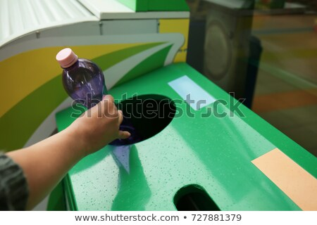 woman on recycling center throwing bottles in container stock photo © kzenon
