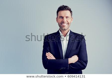 бизнесмен портфель мобильного телефона бизнеса улыбка волос Сток-фото © bedlovskaya