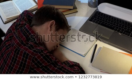 Overworked young schoolboy fallen asleep Stock photo © ozgur