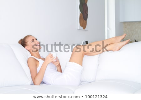 elegant woman in a stylish interior stock photo © konradbak