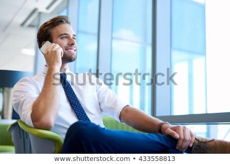 笑みを浮かべて · 小さな · ビジネスマン · 話し · 携帯電話 - ストックフォト © deandrobot
