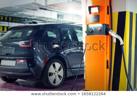 Foto stock: Electric Car At A Charging Point In An Underground Parking