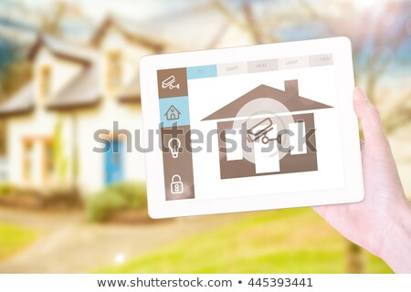 Composite image of feminine hand holding tablet Stock photo © wavebreak_media