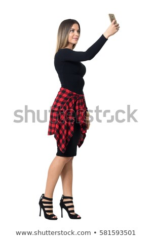 Woman in black dress and high heels with mobile phone Stock photo © deandrobot