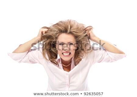 angry woman pulling up her hair stock photo © dazdraperma