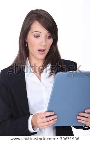 beautiful surprised young woman with clipboard on the wonderful stock photo © massonforstock