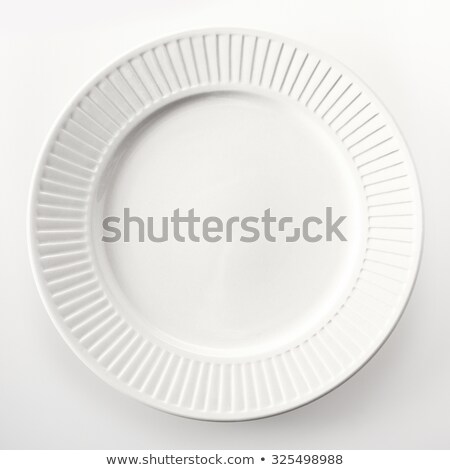 White dinner plate with ridged rim Stock photo © Digifoodstock