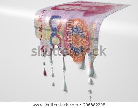 Stock photo: Chinese Yuan Melting Dripping Banknote