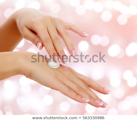 Young woman with beautiful body and smooth soft skin on an abstract background with blurred lights Stock photo © Nobilior