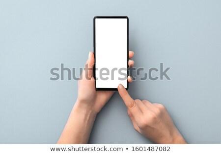 white smartphone gray background stock photo © romvo