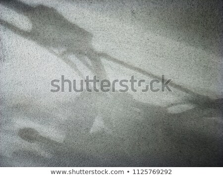 Stock photo: silhouette of street motorcycle on reflective surface