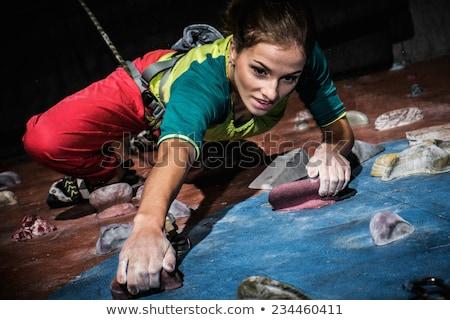 Kadın tırmanma yukarı kaya duvar spor salonu Stok fotoğraf © wavebreak_media