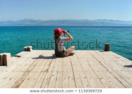 Aranyos lány külső látcső fából készült dokk Stock fotó © jossdiim