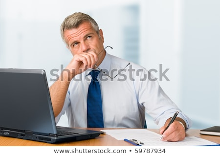 portrait of a man in his office worried stock photo © is2