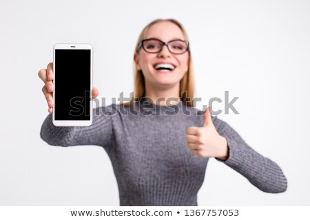 Portrait of blonde in glasses with a tablet in hands Stock photo © Traimak