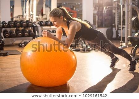 pilates · mujer · estabilidad · pelota · gimnasio · fitness - foto stock © lunamarina