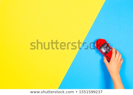 Hand holding small blue car stock photo © Dinga