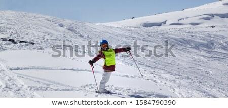 Little skier on ski slope with new fallen snow at sun day Stock photo © BSANI