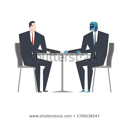 Cyborg imprenditore robot uomo tavola artificiale Foto d'archivio © MaryValery