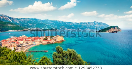 Old town and seashore with pier and beach in Budva in Montenegro Stock photo © bezikus