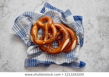 Three german fresh baked pretzel buns placed on napkin Stock photo © dash