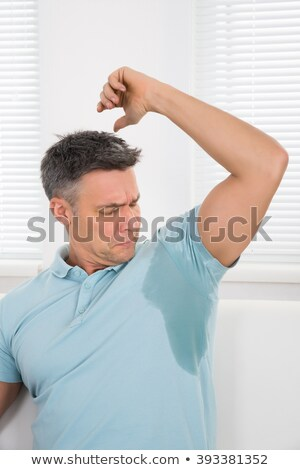 Man Noticing Sweat Under Armpit Stock photo © AndreyPopov