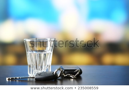 close up of alcohol and car key on table Stock photo © dolgachov