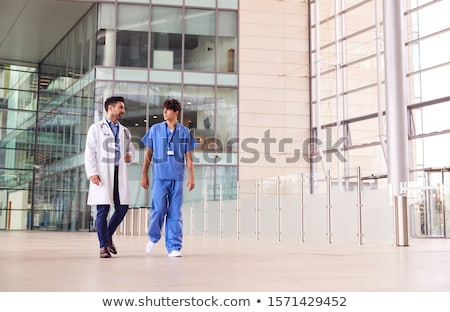 Caucasian Male Nurse In Front Of Hospital Building Stock photo © feverpitch