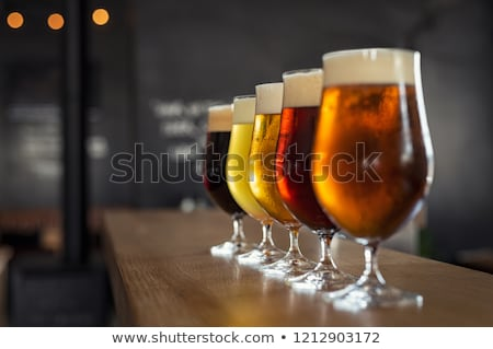 alcoholic drinking beer from glass at night stock photo © dolgachov