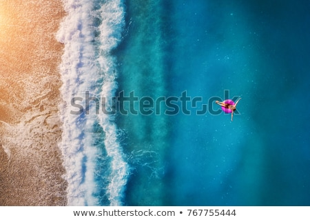 Beautiful girl relaxing on a tropical beach. stock photo © NeonShot