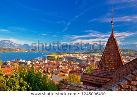 Idyllic view of Luzern rooftops and lake from above Stock photo © xbrchx