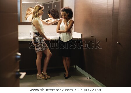 Sad Girl Crying For Problems In Office Toilets With Friend Stock photo © diego_cervo