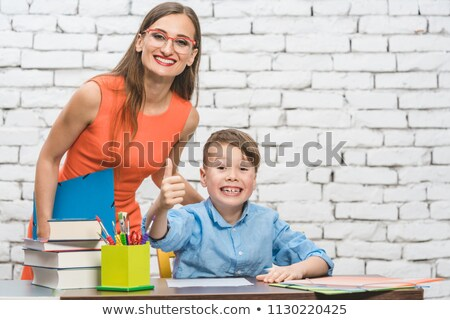 Stock photo: Pupils and teacher showing thumbs-up in school having fun