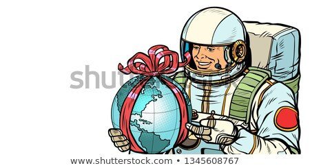 Earth day concept. Astronaut with a gift. Isolate on white background Stock photo © studiostoks