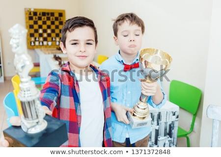 Two boys having won a chess tournament holding trophy Foto stock © Kzenon