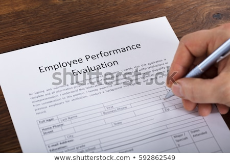 Person Filling Employee Performance Evaluation Form Stock photo © AndreyPopov