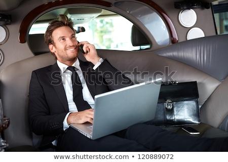 goodlooking businessman talking on mobile stock photo © nyul