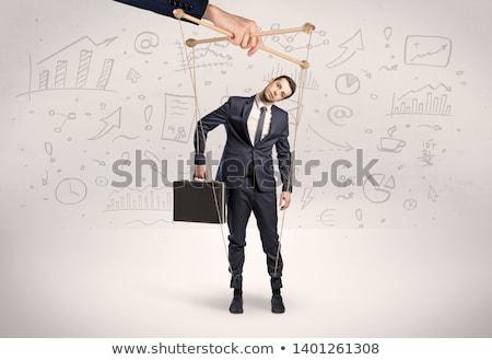 Marionnette employé documents autour grand main Photo stock © ra2studio