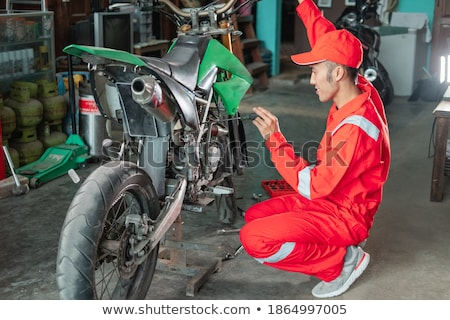 Automotive, mechanic fixing carburetor Stock photo © simazoran