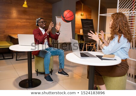 two happy young multicultural students of college playing with ball in cafe stock photo © pressmaster