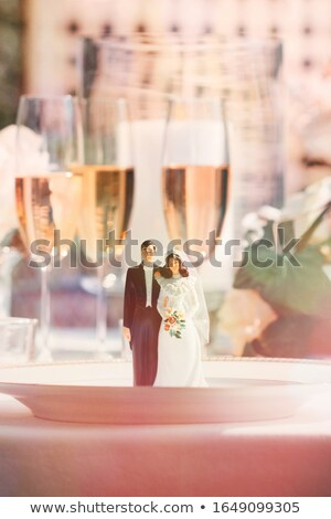Stock photo: Cake figurines on dinner plate at reception