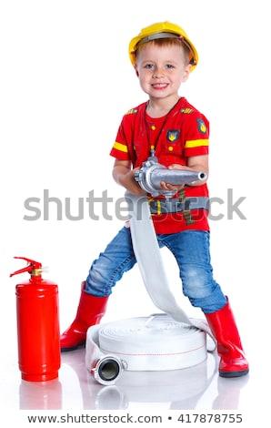 Expressive cute toddler with fireman outfit playing fireman Stock photo © galitskaya
