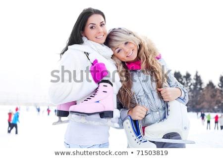 happy beautiful girl wearing warm winter clothes ice skating Stock photo © galitskaya