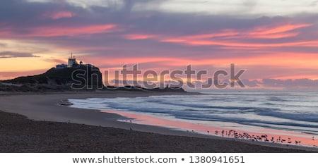 Tengerpart Newcastle Ausztrália gyönyörű napos idő világítótorony Stock fotó © jeayesy