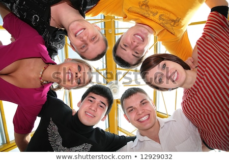 group of friends it stands smiling after being embraced into circle it looks downward stock photo © Paha_L