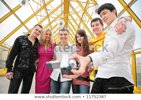 group of young people removes itself to camcorder on footbridge Stock photo © Paha_L