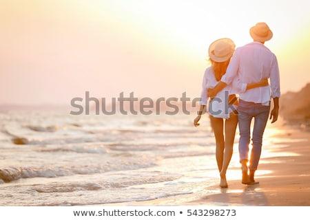 çiftler plaj çift gün batımı adam kalp Stok fotoğraf © pkdinkar