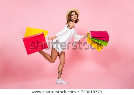 Shopping femme rose sac cute fille Photo stock © Ariwasabi