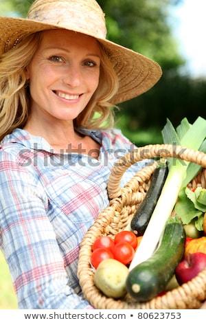 nő · szalmakalap · tart · kosár · zöldségek · gyümölcs - stock fotó © photography33